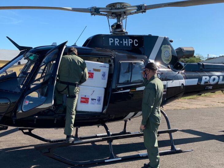 A distribuição é feita por helicóptero e por via terrestre (Foto: Divulgação Polícia Civil)